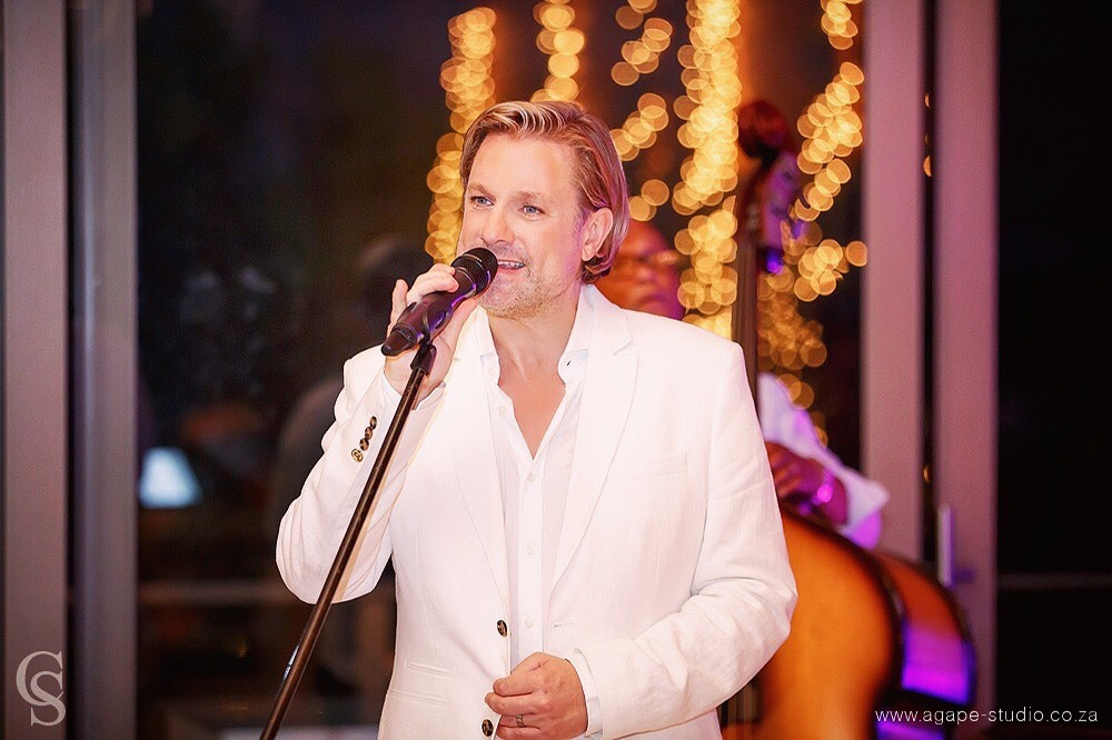 Top wedding singer Ike Moriz at Old Mac Daddy Farm trailer park music band photographed by Charl Smith from Agape Studio Cape Town